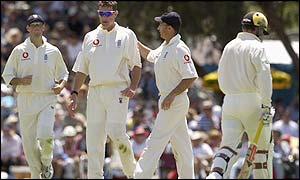 England captain Nasser Hussain congratulates spin bowler Ashley Giles after he took the wicket of Brad Hogg