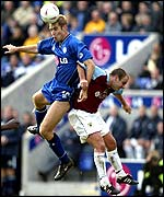 Leicester City's James Scowcroft wins a header against Burnley's Dean West