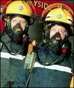 Firemen in breathing apparatus