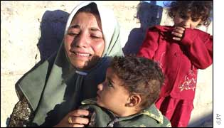 Aisha, the wife of terror suspect Mahmud Issa, breaks down as her home is demolished