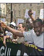 Hundreds of immigrants protest 24 August 2002 in Paris