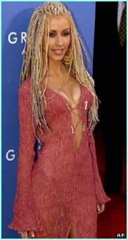 At the Grammy awards in 2001, she's just bursting to show off her dress