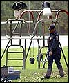 A policewoman walks through a playground