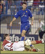 Man Utd Ryan Giggs is challenged by Olympiakos defender Antzas