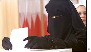 A woman, dressed in an Abaya, votes in Bahrain's election last week