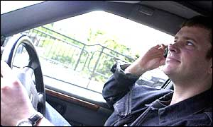 Man driving and talking on mobile phone