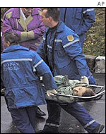 Medics carry an unidentified casualty on a stretcher