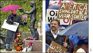 Woman lays flowers by statue of peace activist Samantha Smith (l) while another man marches holding a placard