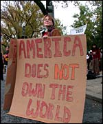 Protest placard: 'America does not own the world'