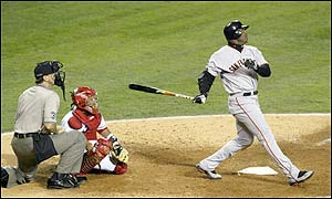 Barry Bonds of the San Francisco Giants hits a home run in the sixth inning giving the Giants a 4-0 lead - Kenny Lofton scores in  the following inning to make it 5-0