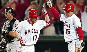 KAnaheim Angels Darin Erstad is congratulated by teammate Tim Salmon after hitting a solo homerun