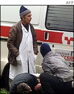Medics attend an unidentified hostage outside the theatre