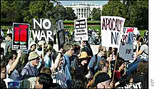 Anti-war protesters march in front of the White House, 26 October, 2002