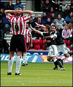 Southampton's James Beattie watches as Lee Clark gives Fulham the lead