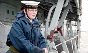 Crew member Kim Davidson surveys the damage on HMS St Albans