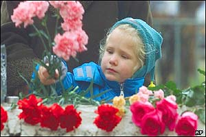A girl deposits flowers