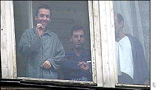 A former hostage at a the window of a Moscow hospital