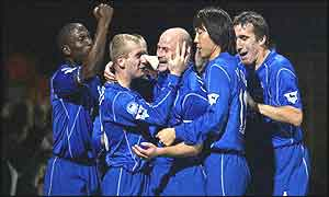 Lee Carsley (centre) is mobbed after Everton's winner