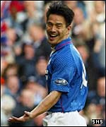 Michael Mols celebrates after scoring at Ibrox