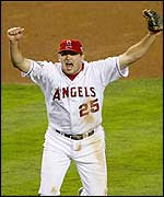 Anaheim Angels' third baseman Troy Glaus celebrates the last out