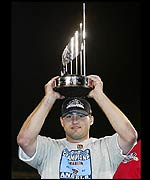 Troy Glaus holds the MVP trophy aloft