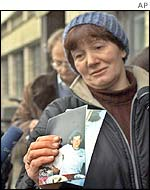 A mother with a picture of her son, one of those held hostage