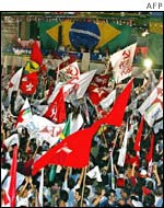 Thousands of supporters wave flags as they hear Lula has won