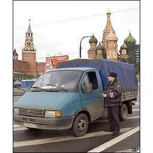 A police officer checks ID documents of a driver near the Kremlin