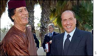 Muammar Gaddafi and Silvio Berlusconi