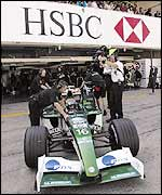 Eddie Irvine's Jaguar pulls out of the pits during qualifying for the Japanese Grand Prix