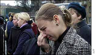 Relative weeps as she awaits news outside a Moscow hospital
