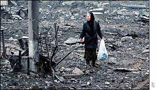 A woman walks among the rubble in the Chechen capital, Grozny