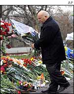 Yuri Luzhkov deposits flowers outside the theatre on Monday