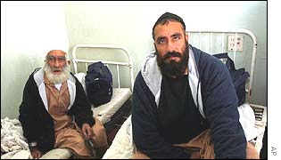 Former Afghan detainees Haji Faiz Mohammed, left, and Jan Mohammed