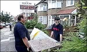 Removal men carrying a washing machine