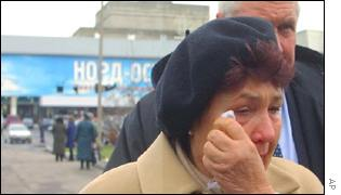 Russian women cries outside theatre