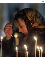 A woman prays in a Moscow church