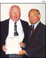 Foley receiving achievement award from US Ambassador Edward Gnehm