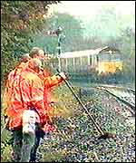 Rail engineers on train tracks