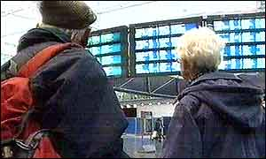 Passengers looking at departure boards