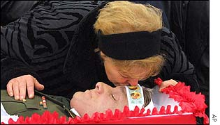 Wife of victim Colonel Konstantin Litvinov kisses dead husband