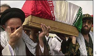 Iranians carry away a coffin