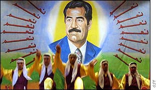 Poster of Saddam Hussein at folk concert