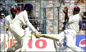 West Indies opener Chris Gayle clings onto a slip catch