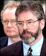 Sinn Fein president Gerry Adams and Martin McGuinness behind