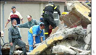Rescue workers in the debris of the school in San Giuliano di Puglia