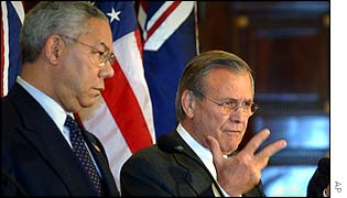 Colin Powell (l) and Donald Rumsfeld