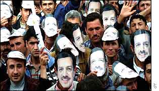 Supporters of AK party ware Erdogan masks at an election rally
