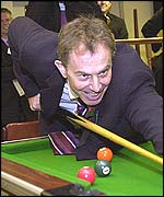 Tony Blair playing pool at the Royal British Legion