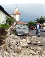 A street in Santa Venerina , Sicily, Italy, heavily damaged by an earthquake Tuesday